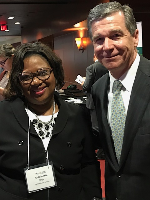 Antoinette Day poses with Governor Roy Cooper