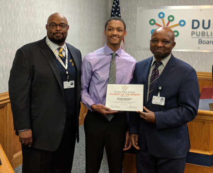 Devin McCoy, DPS Student of the month with Principal, Dan Gilfort and Superintendent Pascal Mubenga
